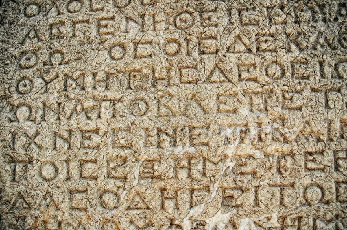 8265891-Stone-background-with-antique-Greek-inscriptions-Stock-Photo-greek-ancient-greece